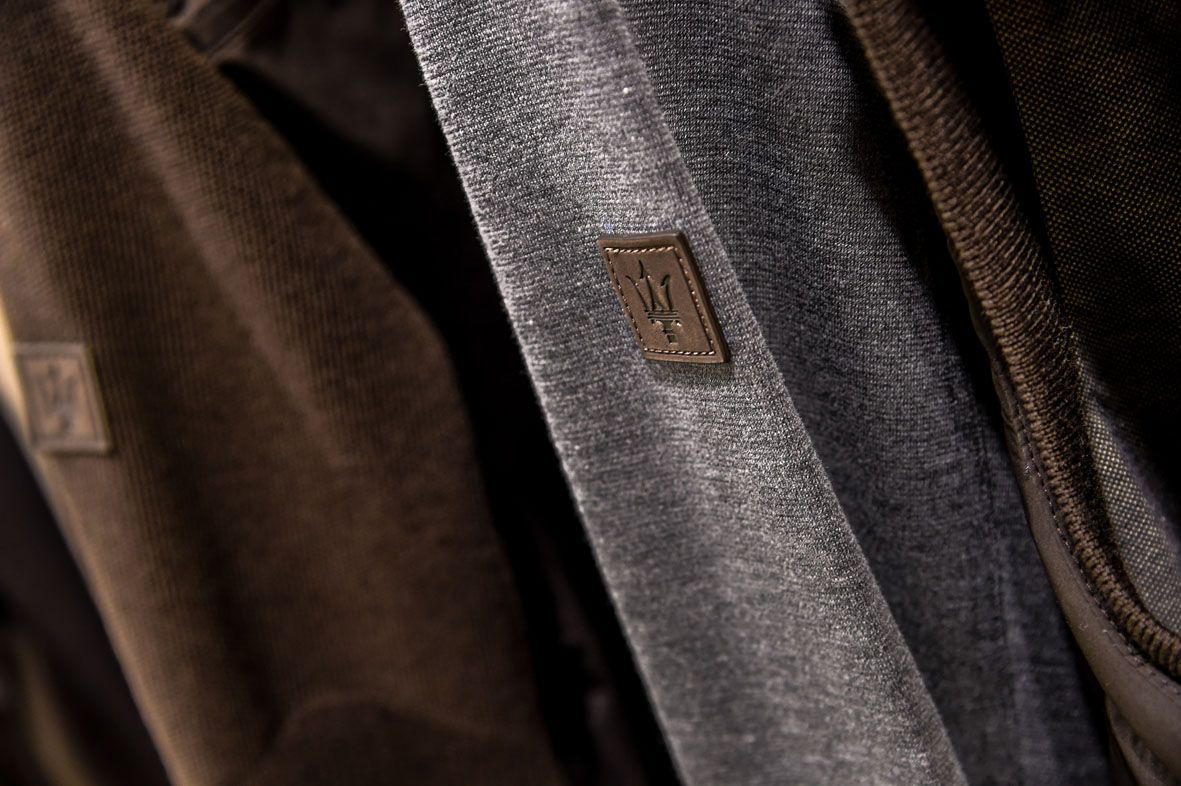 Ermenegildo Zegna as Maserati partner - Maserati logo detail on Zegna clothes