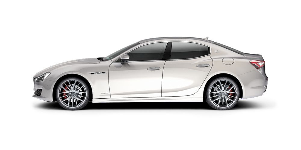 Side view of a white 4 door Maserati Ghibli