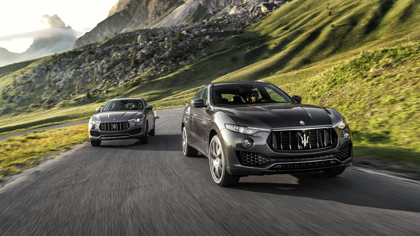 Two Maserati Levante on the road - Grey models front view