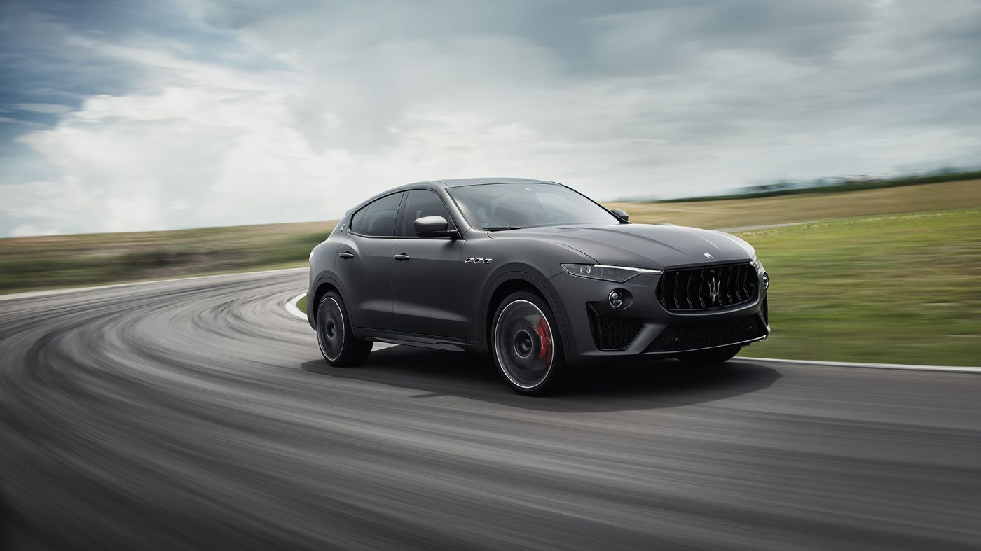 Maserati Levante Trofeo side view, racing on track