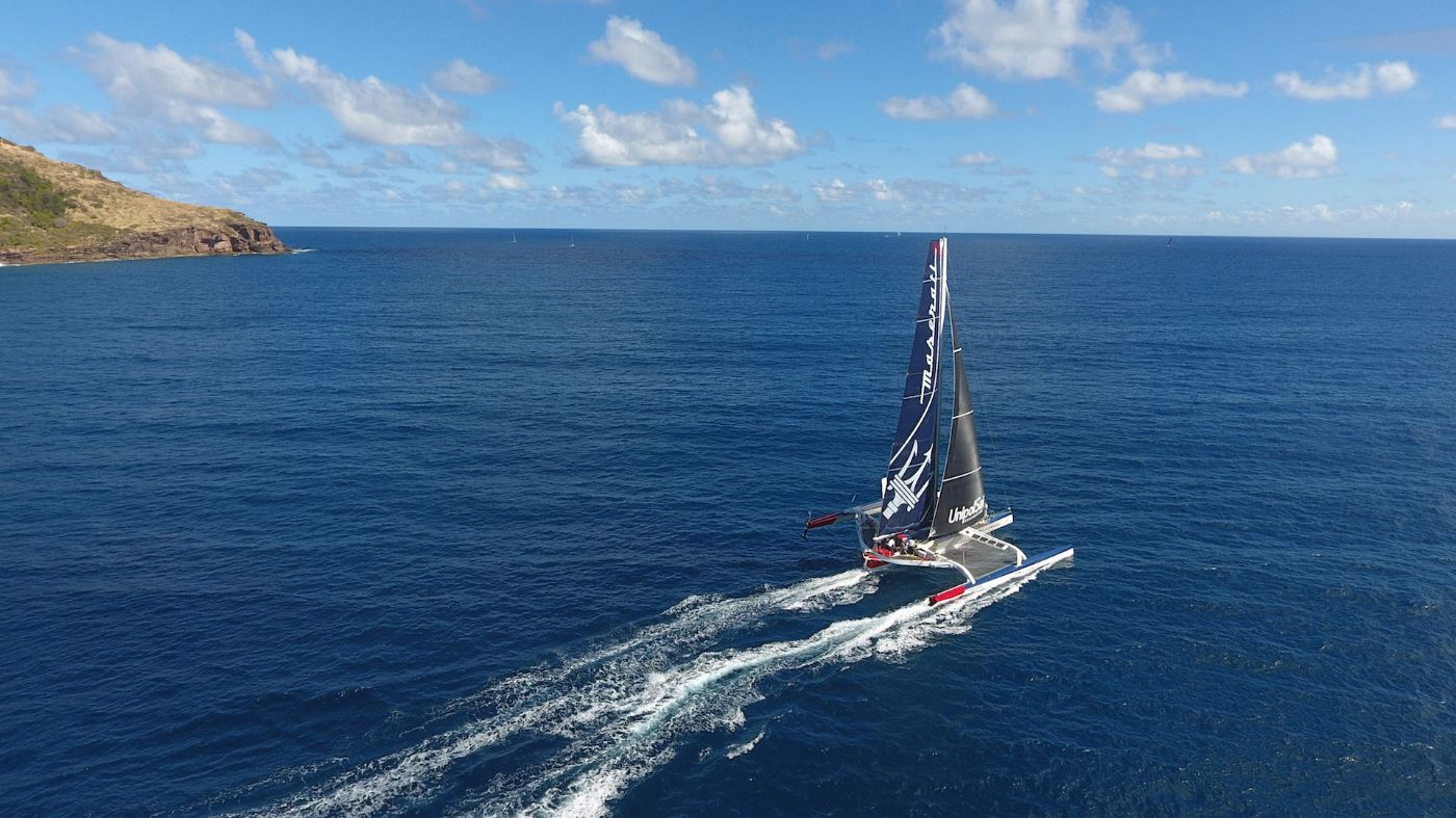 The Maserati Multi70 Trimaran crossing the sea