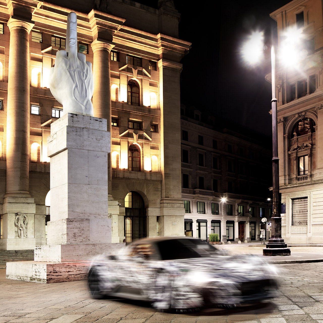 New Maserati MC20 (2020) super sports car prototype testing in Milan - Car next to Cattelan's L.O.V.E sculpture.