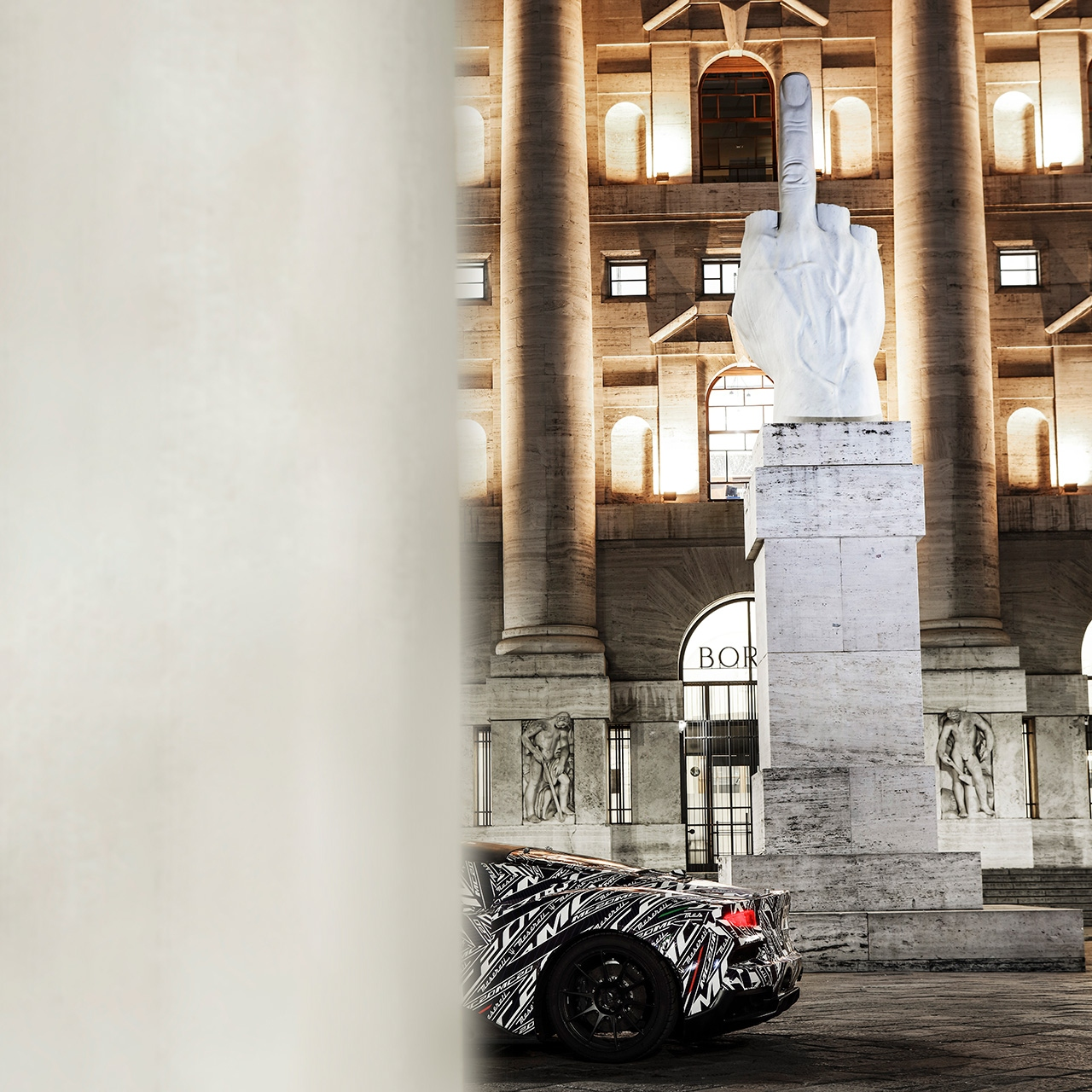 New Maserati MC20 (2020) super sports car prototype testing in Milan, next to Cattelan's L.O.V.E sculpture.