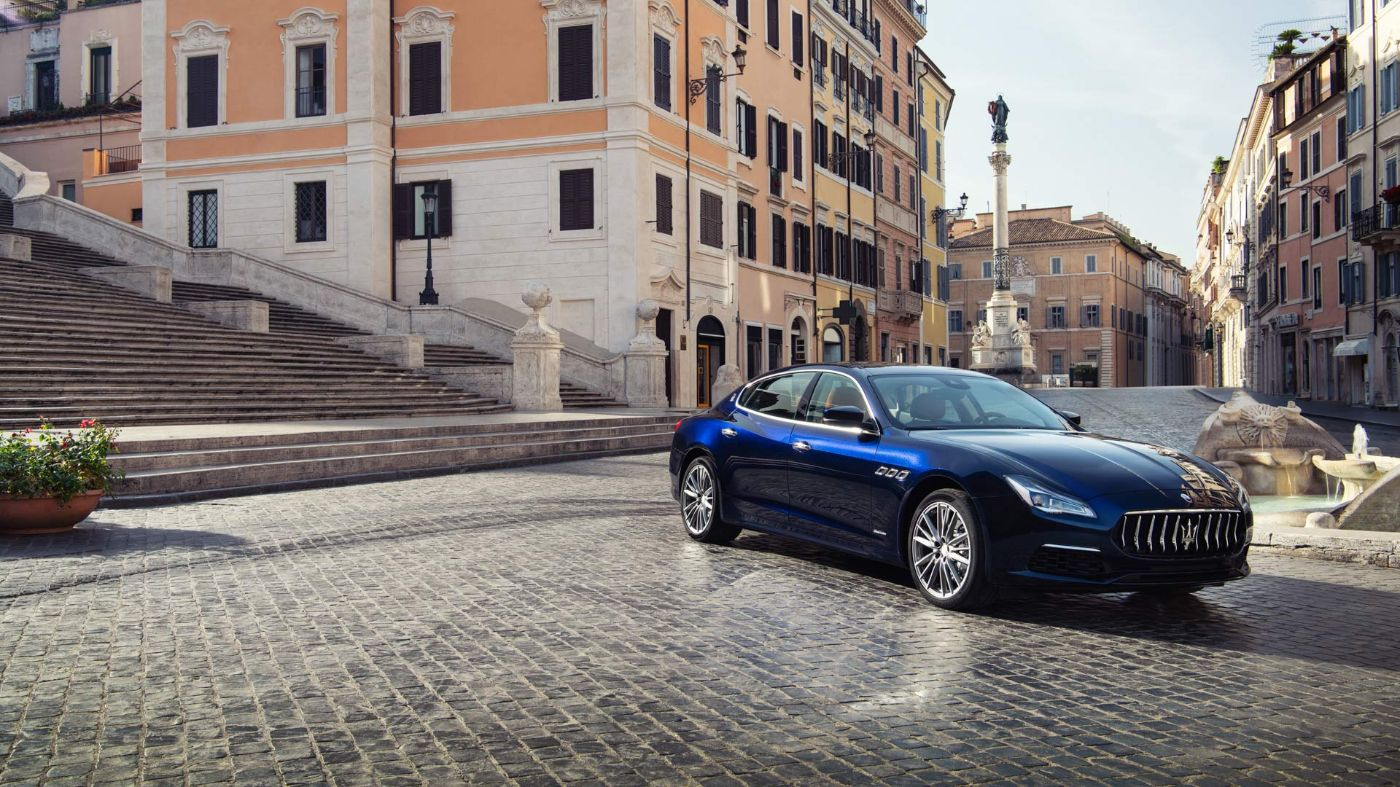 Maserati Quattroporte - Piazza di Spagna (Spanish Square) in Rome on the background