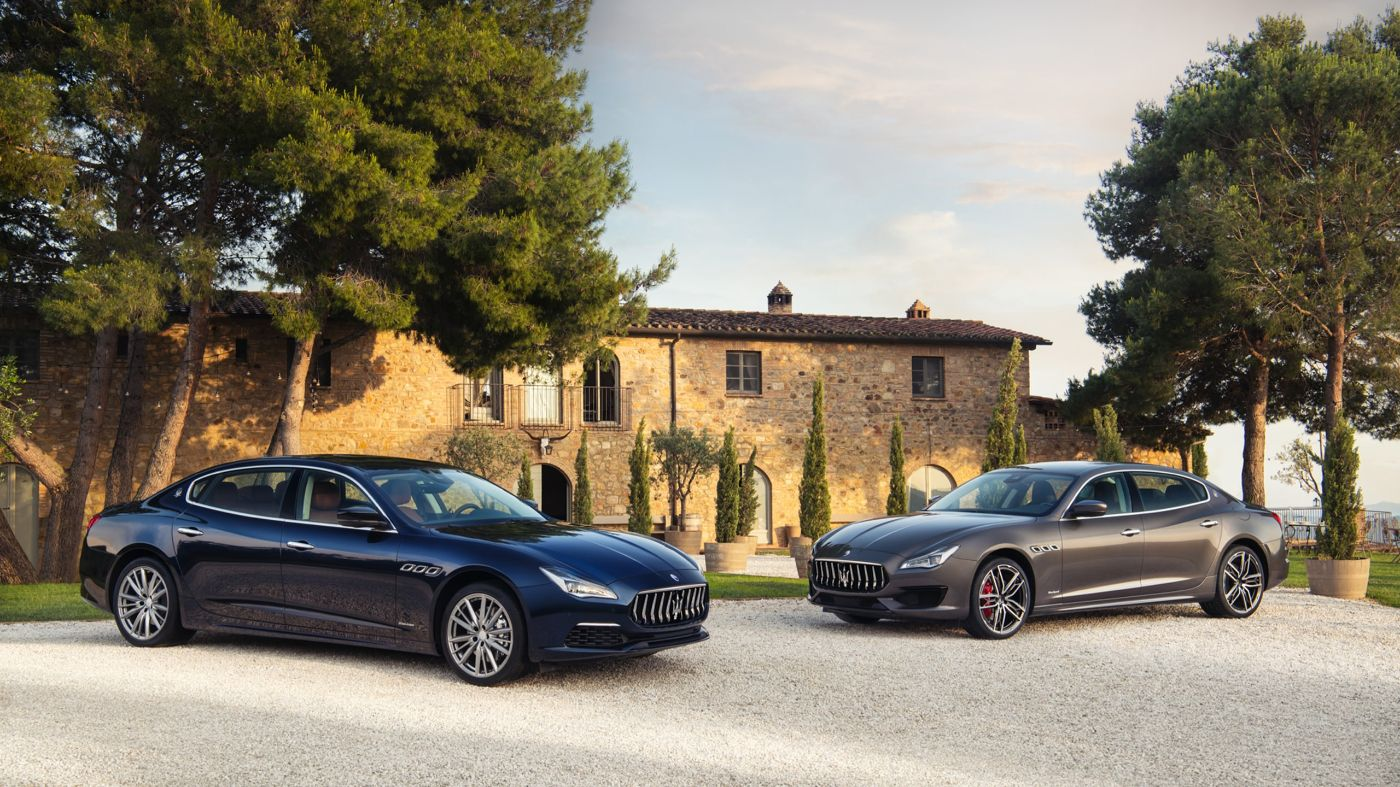 Maserati Quattroporte S and GTS parked in front of an Italian villa