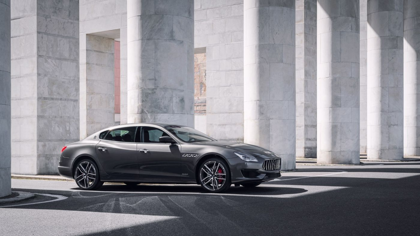 Maserati Ghibli - side view - white wall and columns on the background