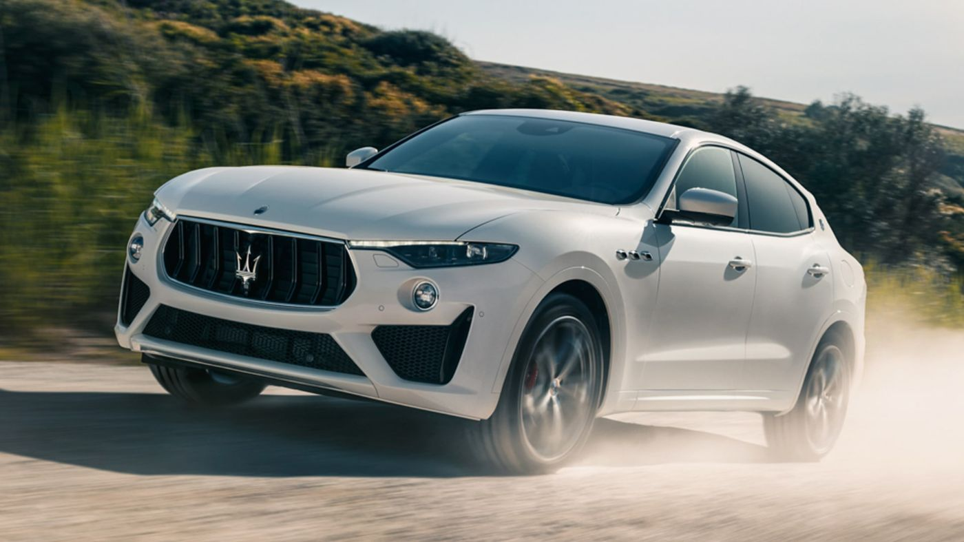 Maserati Levante on a gravel road, front and side view - off-roading